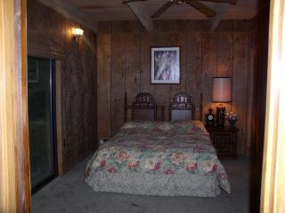Master bedroom with a queen bed
